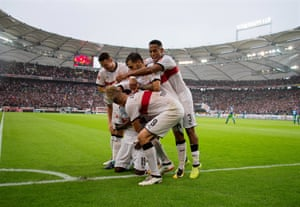 Stuttgart players celebrate the decisive goal in their win over Wolfsburg.
