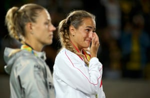 Monica Puig of Puerto Rico and Germany's Angelique Kerber react after receiving their medals.