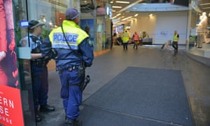 Police guard the Westfield shopping centre in Bondi Junction after part of the roof caved in during a storm on Wednesday.