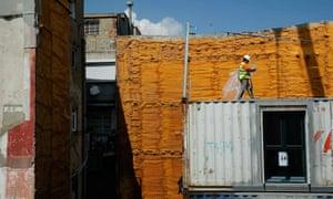 A worker walks on the construction site of the flats on Carrer Nou de Sant Francesc.