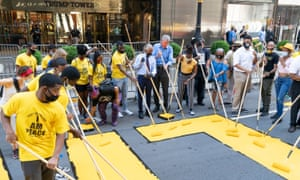 De Blasio, Al Sharpton and other volunteers paint a Black Lives Matter mural outside Trump Tower.