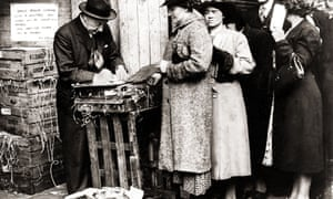 Food queues at Covent Garden market in London during the Second World War.