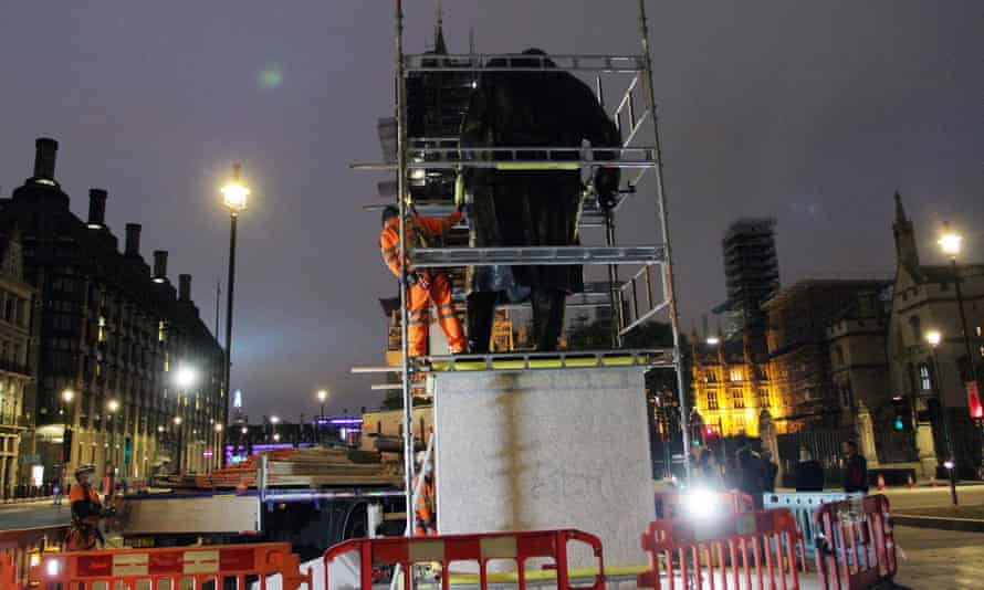 The statue of Winston Churchill in central London being boarded up