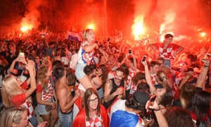 SPLIT, CROATIA - JULY 12: Fans of Croatia celebrate after Croatia advances to their first World Cup final after beating England 2-1 in the 2018 FIFA World Cup Russia Semi Final
