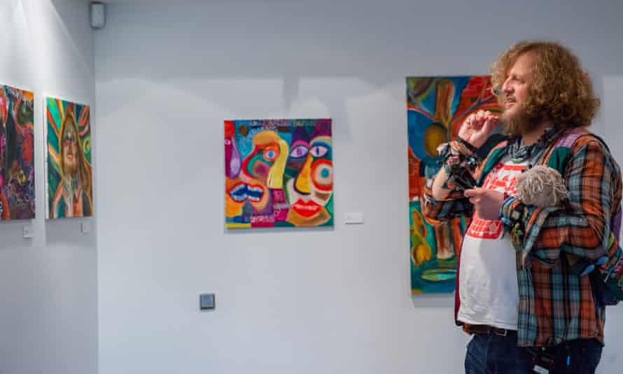 Jeffrey Johns with some of his paintings from Big Jeff Johns – Welcome to My World.