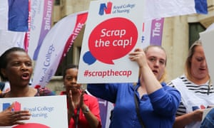 Members of the Royal College of Nursing stage a pay protest in Whitehall, Westminster, in June.