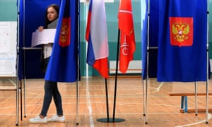 A woman casts a vote in St Petersburg on Sunday.