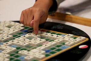 Young boy playing scrabble