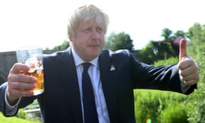 """Former London Mayor, and """"Vote Leave"""" campaigner, Boris Johnson is pictured with a pint of beer giving a thumbs up ahead of meeting with members of the public and supporters in Piercebridge, near Darlington, north-east England on June 22, 2016, as he continues to campaign for a Brexit ahead of the June 23 EU referendum. Wednesday is the last day of campaigning for Britain's referendum on whether or not to stay in the EU, a momentous decision with far-reaching implications for Britain and Europe. / AFP PHOTO / SCOTT HEPPELLSCOTT HEPPELL/AFP/Getty Images"""