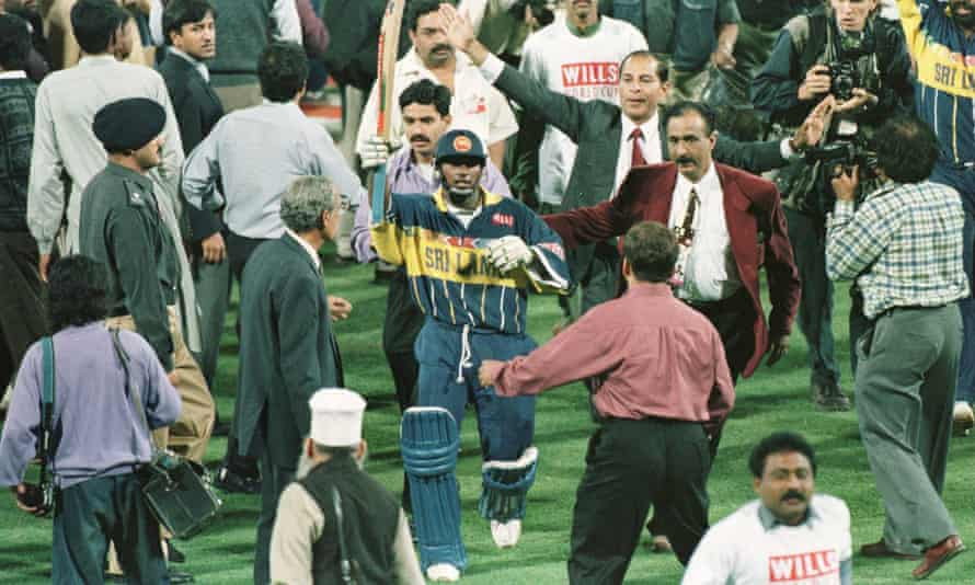 Aravinda De Silva raises his bat in triumph as he leaves the field after leading Sri Lanka to victory in the 1996 World Cup final against Australia in Lahore.