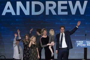 Andrew Scheer and his family wave to supporters
