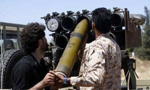 Fighters loyal to the UN-recognised Government of National Accord load a launcher during fighting south of Tripoli.