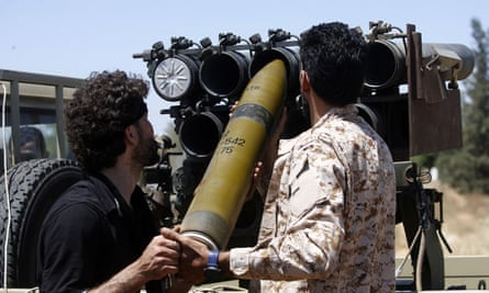 Forces loyal to the Libyan government load a weapon