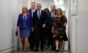 Tony Abbott arrives for the ballot surrounded by fellow MPs at Parliament House in Canberra.