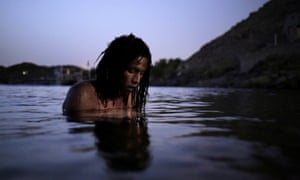 Reesha, a 38-year old Nubian from Heisa Island, swims in the river Nile