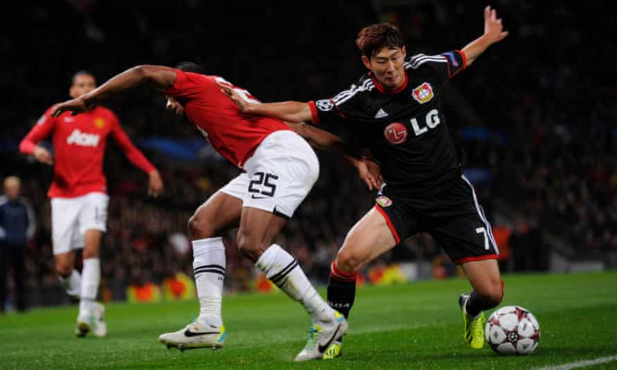 Son Heung-min holds off Antonio Valencia during Bayer Leverkusen's Champions League visit to Old Trafford in 2013.