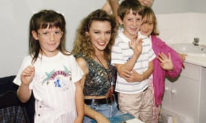 Kylie Minogue with a group of young fans on the set of TV's 'Going Live!', 1989