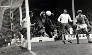 The Leeds goalkeeper Gary Sprake makes a flying save from Manchester City's Ian Mellor, right, 1971.