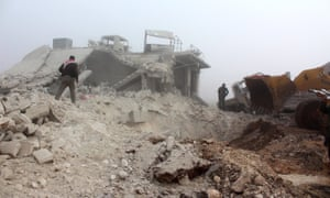 People inspect the wreckage after airstrikes hit the Etarib district of Aleppo, Syria, on Sunday.
