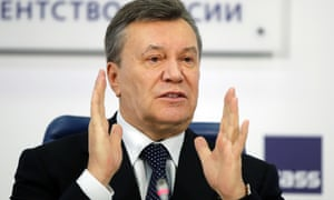Viktor Yanukovych at a news conference in Moscow