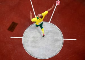 Andrius Gudžius of Lithuania unleashes the discus on his way to winning Gold.
