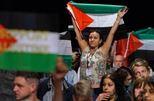 Palestinian supporters wave Palestinian flags during a motion