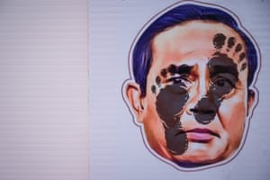 A picture of the face of the Prime Minister of Thailand, Prayuth Chan-ocha, with foot marks on it in Bangkok. Feet are considered dirty in Thailand and this is a sharply insulting image. Student protesters called for his resignation, that the budget of the monarchy and the military be cut during the pandemic, and the importation of mRNA coronavirus vaccines that have yet to be brought to Thailand on a large scale to fight a growing surge in cases.