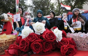 Women celebrate International Women's Day at Tahrir Square in the Iraqi capital