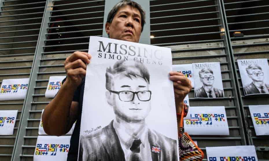A protester holds an illustration of Simon Cheng during a gathering outside the British Consulate in Hong Kong. Cheng was released on Saturday.