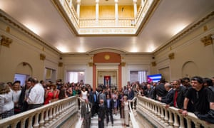 Visitors stand on the second floor of the main atrium of the newly reopened Cuban embassy in Washington.