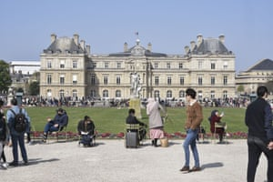 Parisians take a walk in front of the Senat, a park in the Luxembourg garden on 4 April, Easter Sunday in Paris.