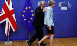 Theresa May with European commission president Jean-Claude Juncker in Brussels.