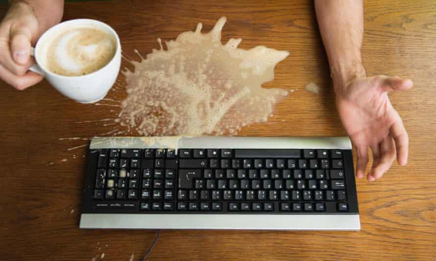 Man Spilling Coffee on KeyboardF1BCRD Man Spilling Coffee on Keyboard