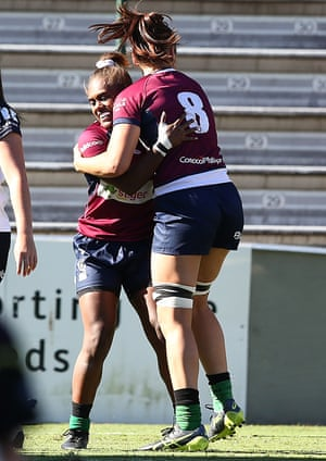 Ivania Wong of the Reds (left) celebrates her try during the Super W Playoff match between Queensland and the Brumbies at Ballymore.