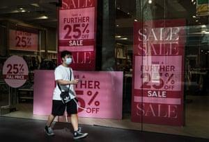 A man walks past a clothing store in Sydney's Pitt Street mall