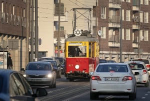 A historic tram marked with the Star of David drives on the streets of Warsaw, Poland