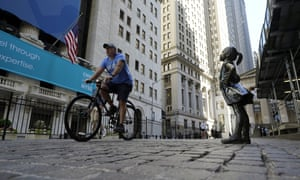"""The """"Fearless Girl"""" statue facing the New York Stock Exchange, today."""