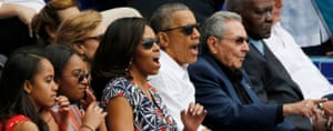 Barack Obama, Michelle Obama and their daughters Sasha and Malia with Raul Castro at a baseball game
