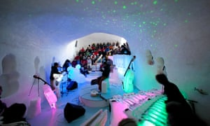 Performers and crowd at artist Tim Linhart s ice cave concert hall in  Luleå e960e23cec279