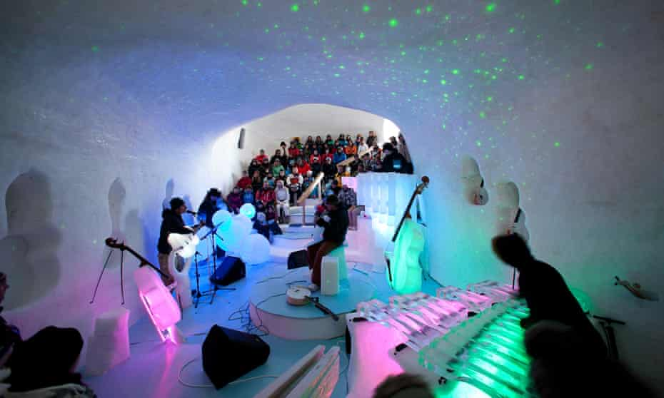 Performers and crowd at artist Tim Linhart's ice cave concert hall in Luleå, Sweden.