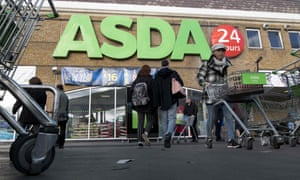 Customers at a branch of Asda supermarket in south London.