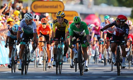 Peter Sagan (in white) was penalised for a shove on Wout Van Aert (yellow) as Caleb Ewan (right) beat the green jersey holder Sam Bennett to the stage win.