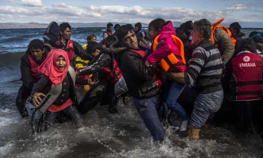 Migrants arrive on the Greek island of Lesbos after crossing the Aegean Sea from Turkey.