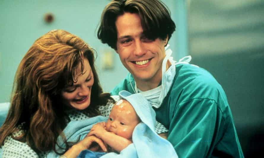 Julianne Moore and Hugh Grant with what looks like a fake baby.