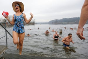 Moosseedorf, Switzerland<br>Brave swimmers get out of the four degree Celsius cold water of the Moossee lake, after their traditional New Year's Eve swim