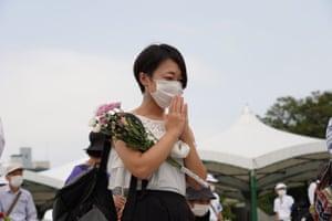 A woman prays at the Hiroshima peace memorial ceremony