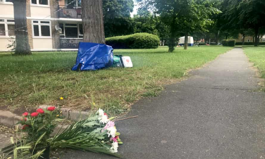Flowers and medical equipment left at the scene of a teenager's murder in Wandsworth, London