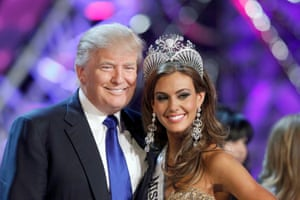 Donald Trump poses with Miss Connecticut Erin Brady at a news conference after she was crowned Miss USA 2013 in Las Vegas, Nevada.
