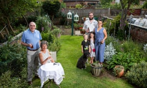 Barbara Seymour and family in her garden.