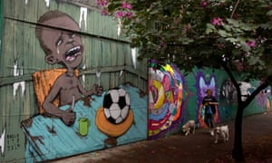 A mural in Sao Paulo by street artist Paulo Ito, created ahead of the 2014 World Cup in Brazil, shows a crying child with only a football to eat